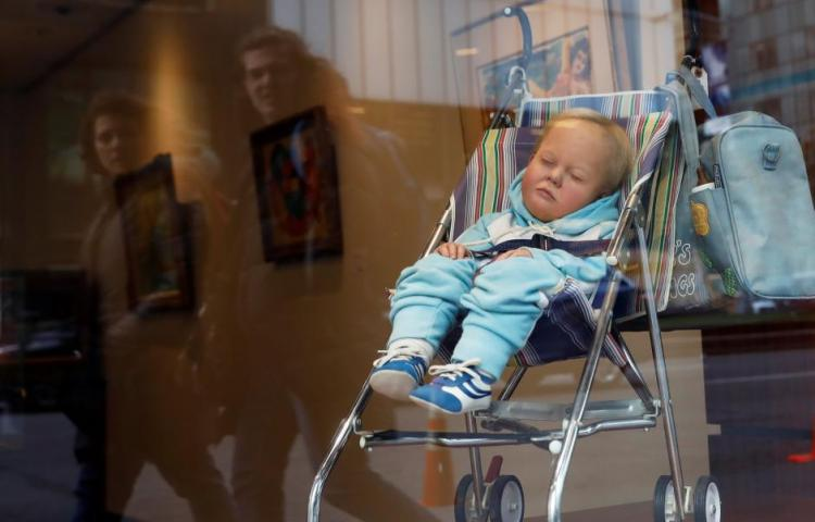 "Artist Duane Hanson's sculpture titled ""Baby in a Carriage, 1983,"" valued at about $80,000 to $120,000, is seen in the Park Avenue window of Heritage Auctions in New York City, New York, U.S., November 10, 2017. REUTERS/Shannon Stapleton"