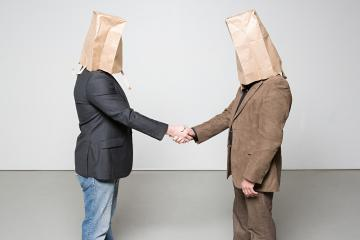 Men with paper bags on their heads
