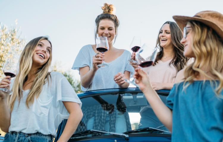 Friends drinking wine in convertible car, Firenze, Toscana, Italy, Europe