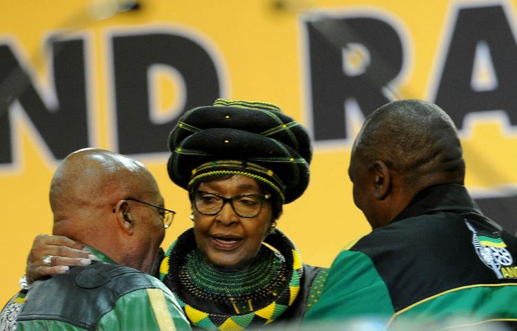 JOHANNESBURG, SOUTH AFRICA – DECEMBER 16: Outgoing ANC President Jacob Zuma and his deputy Cyril Ramaphosa with share a moment with party veteran Winnie Madikizela-Mandela during Zuma's final speech at the party's 54th national elective conference at the Nasrec Expo Centre on December 16, 2017 in Johannesburg, South Africa. In his speech' Zuma reminded the ANC of the journey it had taken in 2017' remembering the longest-serving president of the ANC' Oliver Reginald Tambo. (Photo by Gallo Images / Sowetan / Veli Nhlapo)