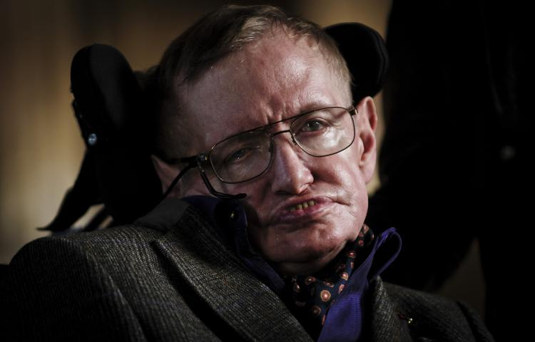 """Professor Stephen Hawking at the Premier of the biopic of his life, """"Hawking"""" which is premiering at a Gala performance at Emmanuel College in Cambridge before going on general release tomorrow. Hawking passed away aged 76 on the 14th March 2018.   © Jason Bye / eyevine  Contact eyevine for more information about using this image: T: +44 (0) 20 8709 8709 E: info@eyevine.com  http:///www.eyevine.com"""
